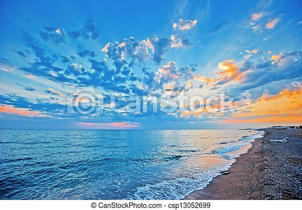 Sunset sky over the sea, sandy beac - csp13052699