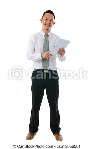 asian business man standing holding a digital touch screen tablet computer on white background.   - csp13056581