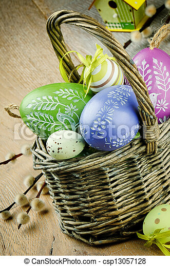 Basket with colorful Easter eggs - csp13057128