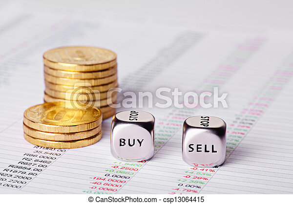 Chart, coins and dices cubes with words Sell Buy. Selective focus - csp13064415