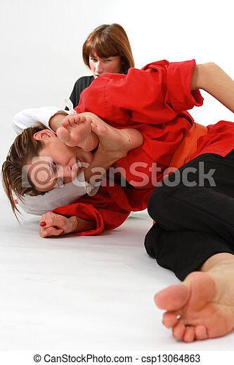 women fighting martial arts - csp13064863