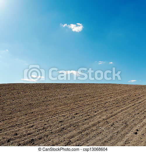 blue sky and black agriculture field - csp13068604