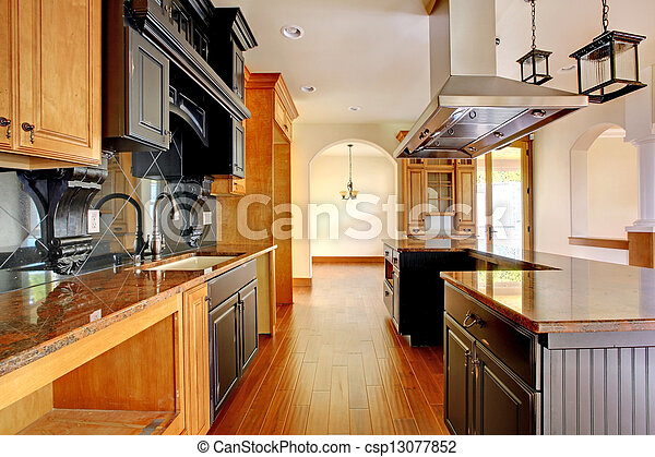 New construction luxury home interior. Kitchen with beautiful details. - csp13077852