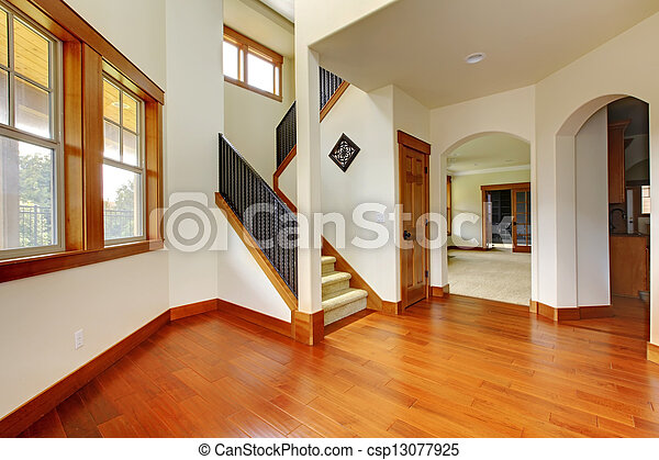 Beautiful home entrance with wood floor. New luxury home interior. - csp13077925