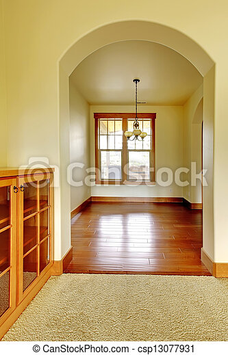 Arch doorway with empty room and wood cabinet. New luxury home interior. - csp13077931