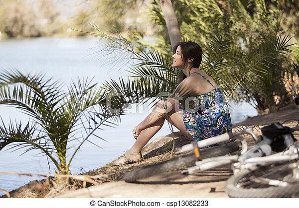 Taking a break by the lake - csp13082233