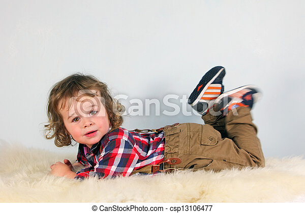 Little boy in rural clothes - csp13106477