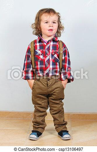 Little boy in rural clothes - csp13106497