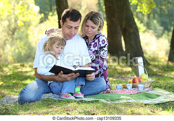 family read the Bible in nature - csp13109335
