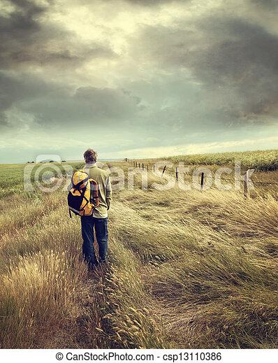 Man walking down country road  - csp13110386