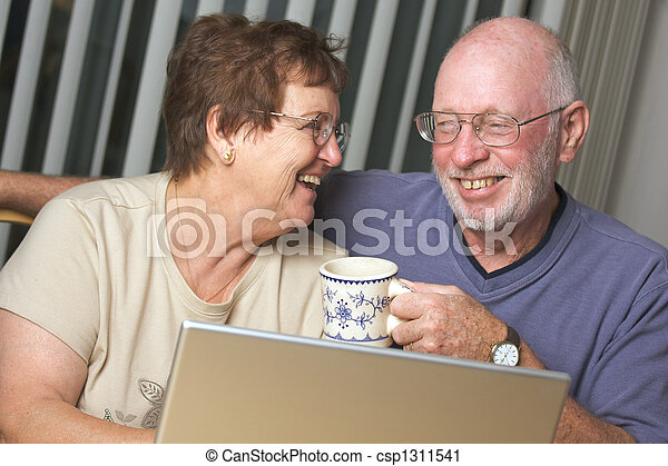 Senior Adults on Laptop Computer - csp1311541