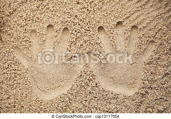 Father and son hand print in sand