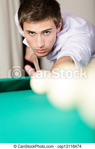 Male playing billiard at gambling club - csp13118474