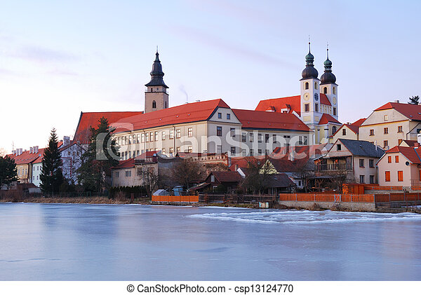 Telc historic chateau and church towers in sunset light - csp13124770