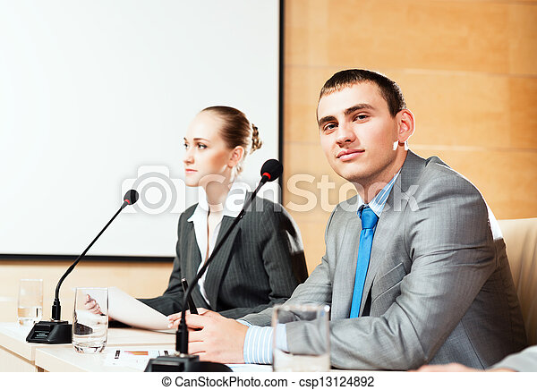 businessmen communicate at the conference - csp13124892