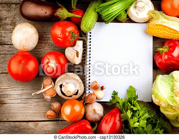 Open Notebook and Fresh Vegetables Background. Diet  - csp13130326