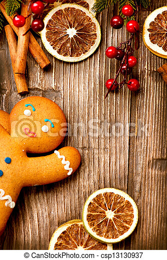 Christmas Holiday Background. Gingerbread Man over Wood - csp13130937