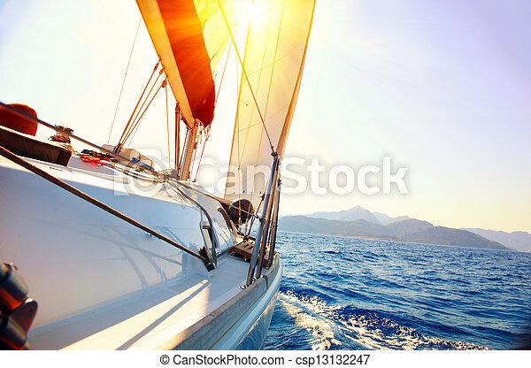 Yacht Sailing against sunset. Sailboat. Yachting. Sailing - csp13132247