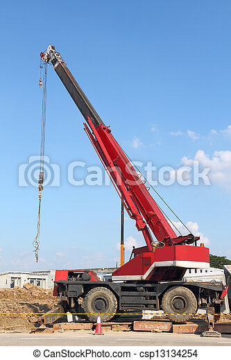 Red automobile crane against blue sky - csp13134254