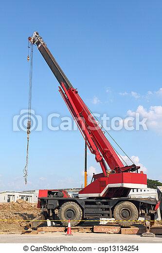 Red automobile crane against blue sky - csp13134254