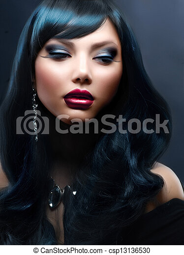 Beautiful Woman With Black Hair and Holiday Professional Makeup - csp13136530