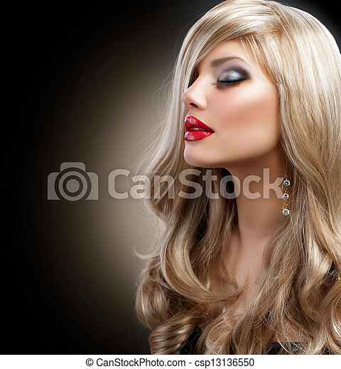 Beautiful Blond Woman with Holiday Makeup over Black - csp13136550