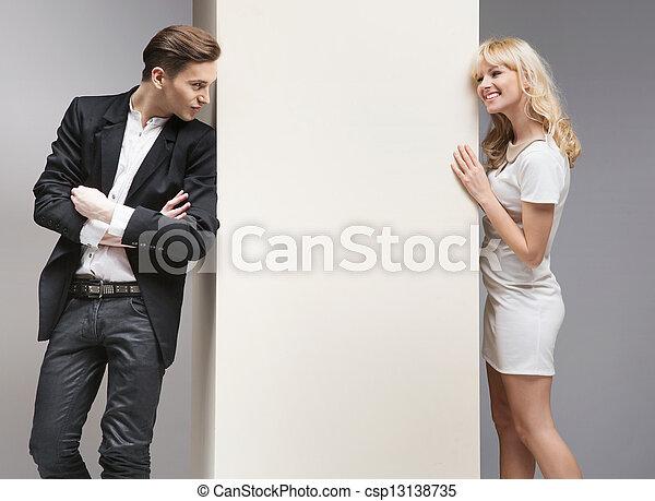 Soft flirt between attractive couple - csp13138735