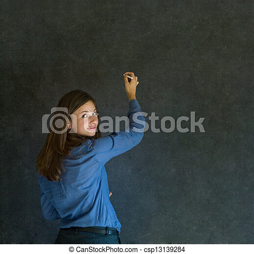 Woman writing on dark blackboard background - csp13139284