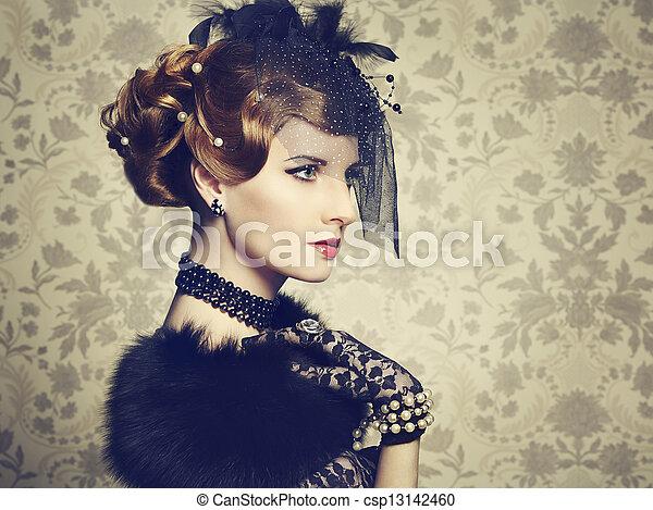 Retro portrait of  beautiful woman. Vintage style - csp13142460