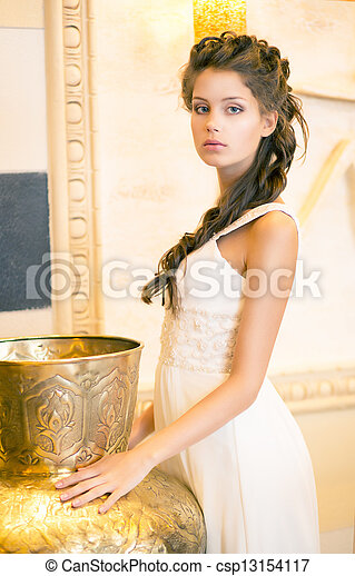Luxurious Posh Brunette in White Dress. Oriental Antique Golden Decor - csp13154117