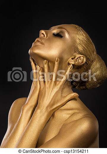 Coloring. Gilt. Golden Plated Woman's Face. Art concept. Gilded Body. Focus on her hands - csp13154211