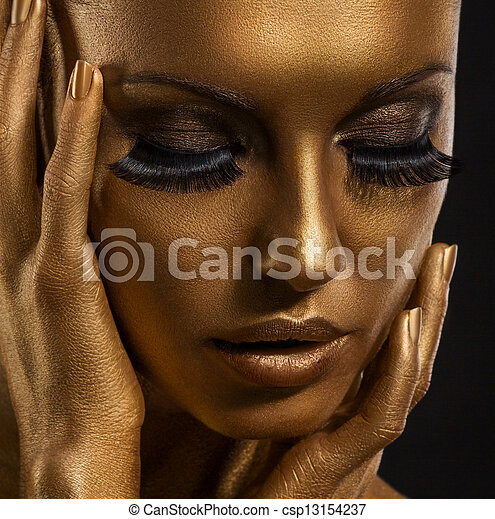 Gilt. Golden Woman's Face Closeup. Futuristic Giled Make-up. Painted Skin - csp13154237