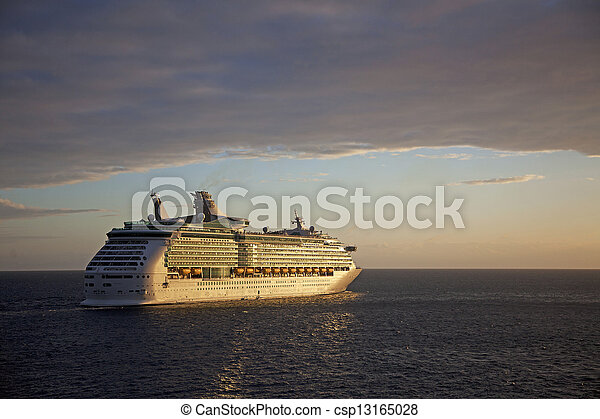 Cruise Ship Sails into Sunset - csp13165028