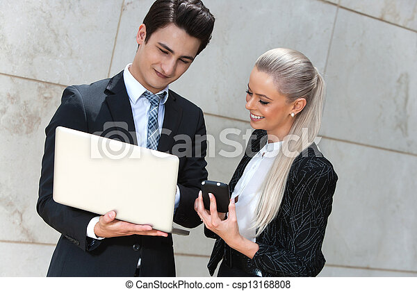 Business couple reviewing data. - csp13168808