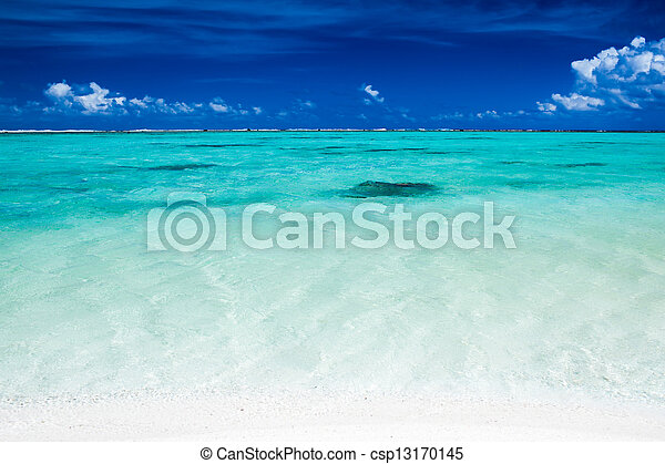 Tropical ocean with blue sky and vibrant ocean colors - csp13170145
