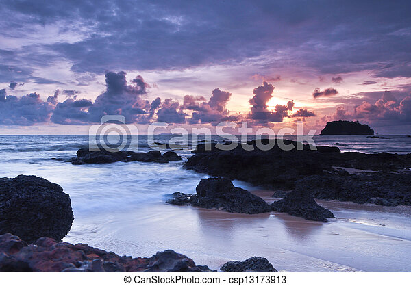 Sunset scene on sea coast - csp13173913