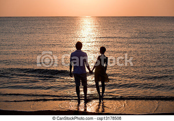 The image of two people in love at sunset - csp13178508