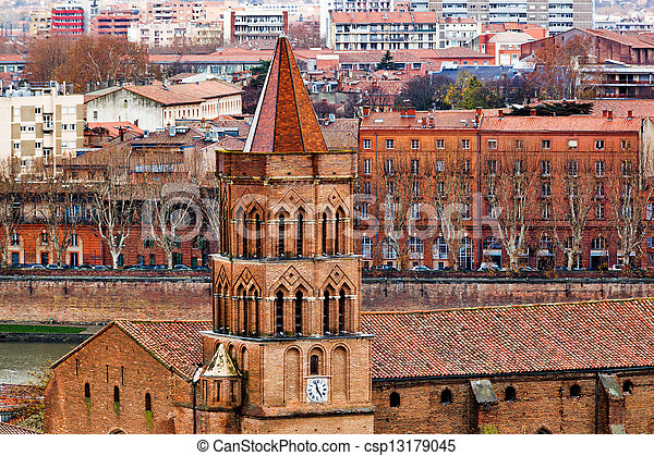 Saint Nicolas church on Toulouse background - csp13179045