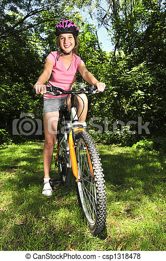 Teenage girl on a bicycle - csp1318478