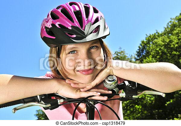 Teenage girl on a bicycle - csp1318479