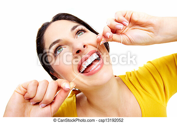 Beautiful woman with a dental floss. - csp13192052