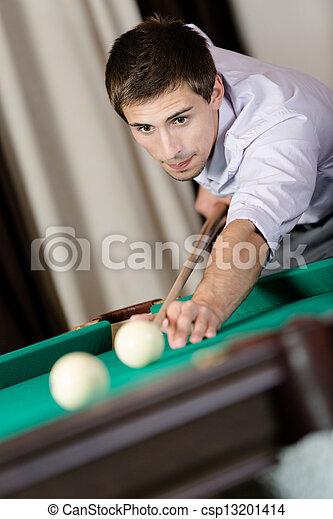 Male playing billiards at gambling club - csp13201414