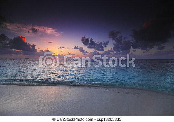 Sunset on beach - csp13205335