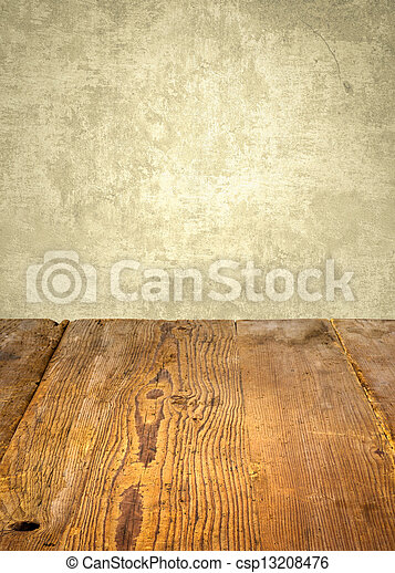 antique wooden table in front of weathered wall - csp13208476