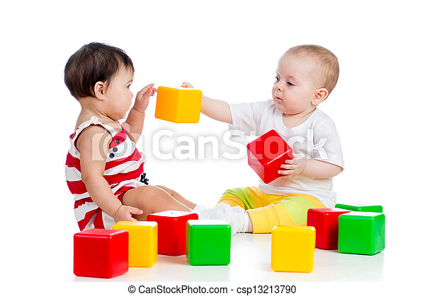 two babies or kids playing together with color toys  - csp13213790