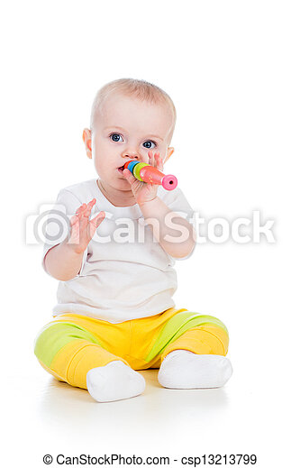 baby  girl playing with musical toy isolated on white - csp13213799