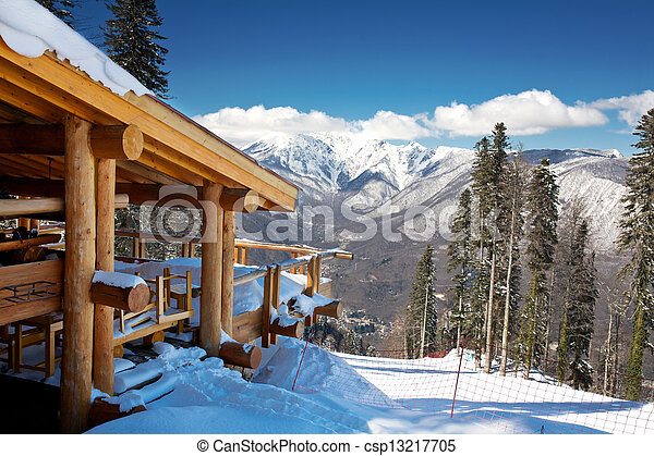 Wooden ski chalet in snow, mountain view - csp13217705