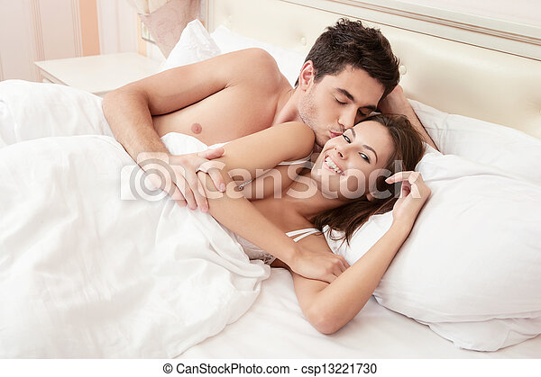 Young adult couple in bedroom - csp13221730