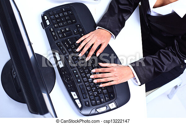 Female hands typing on computer keyboard - csp13222147
