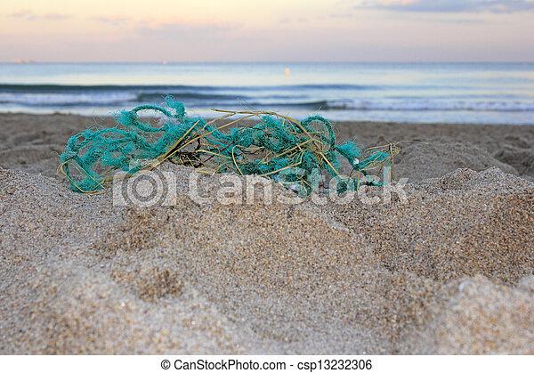 Old Fishing Net on Beach - csp13232306